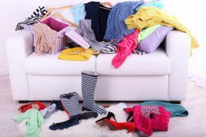 Clothes draped over sofa